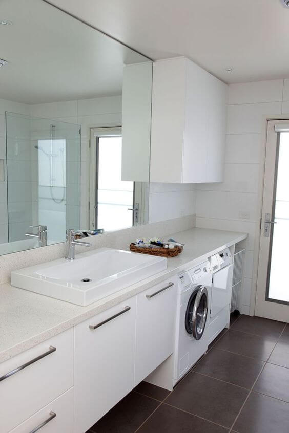 A combined laundry and bathroom for Bathroom and laundry designs